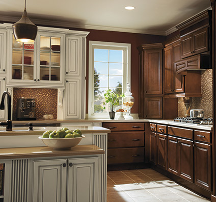 Heritage kitchen cabinets in Maple Bison finish with Ivory accents