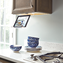 Kitchen cabinet with a tablet holder