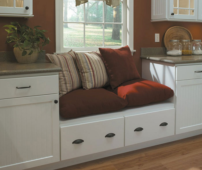 White beadboard kitchen cabinets by Homecrest Cabinetry