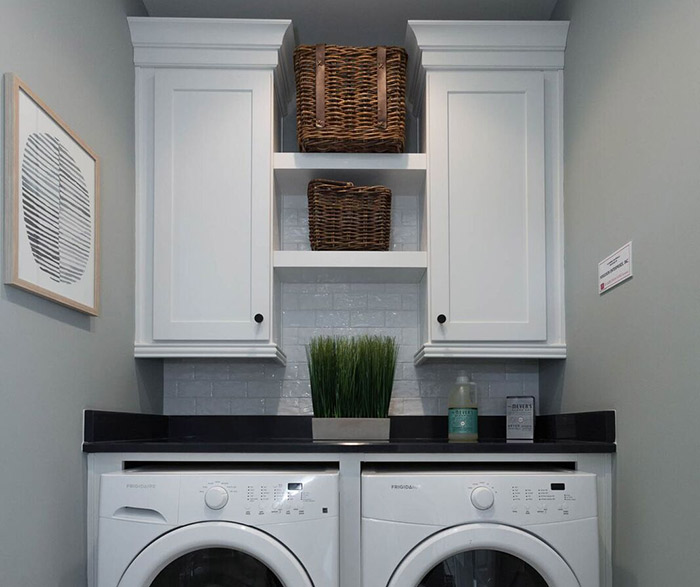 White laundry room cabinets in the Dover door style