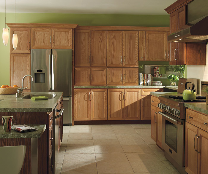 Natural Oak cabinets with a dark kitchen island