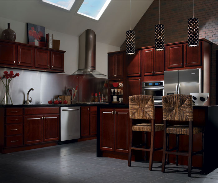 Burgundy cabinets in a contemporary kitchen by Homecrest Cabinetry