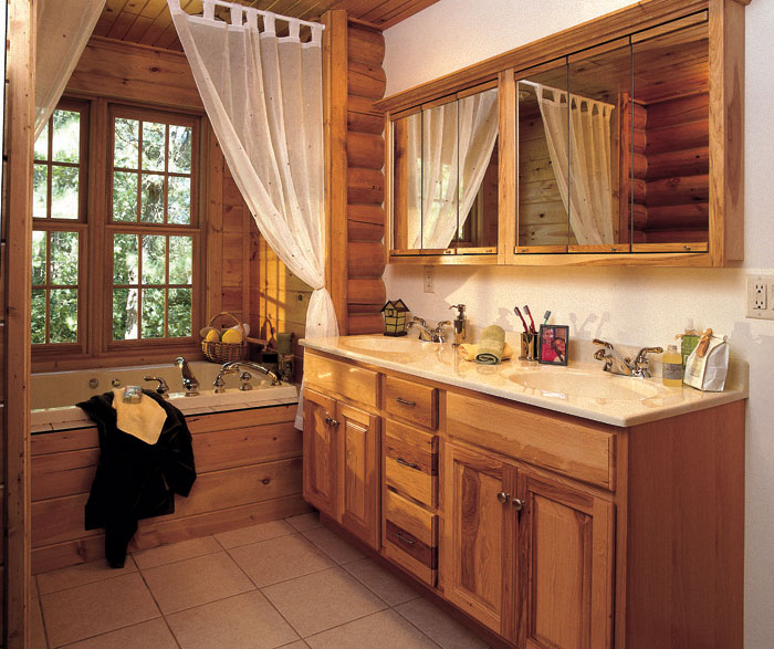Natural Hickory cabinets in a rustic bathroom by Homecrest Cabinetry