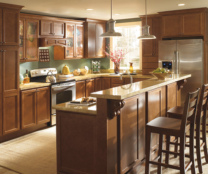 Laurel Maple cabinets with a bi-level kitchen island in the Terrain finish