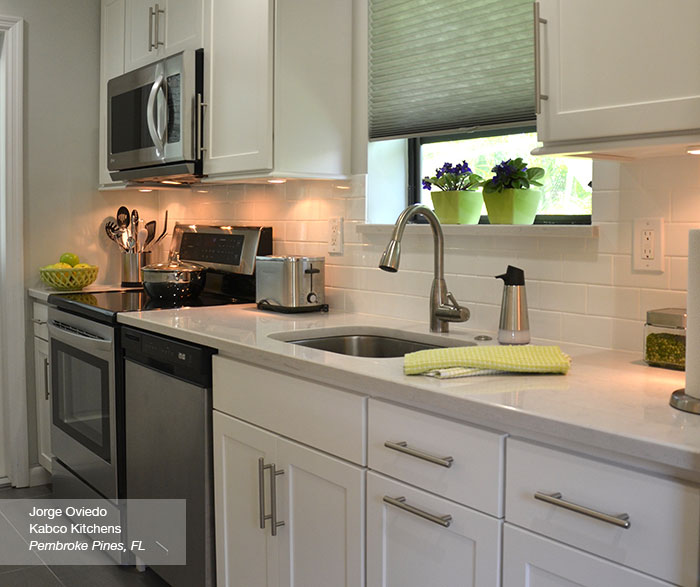 White Sedona Shaker style cabinets in a galley kitchen