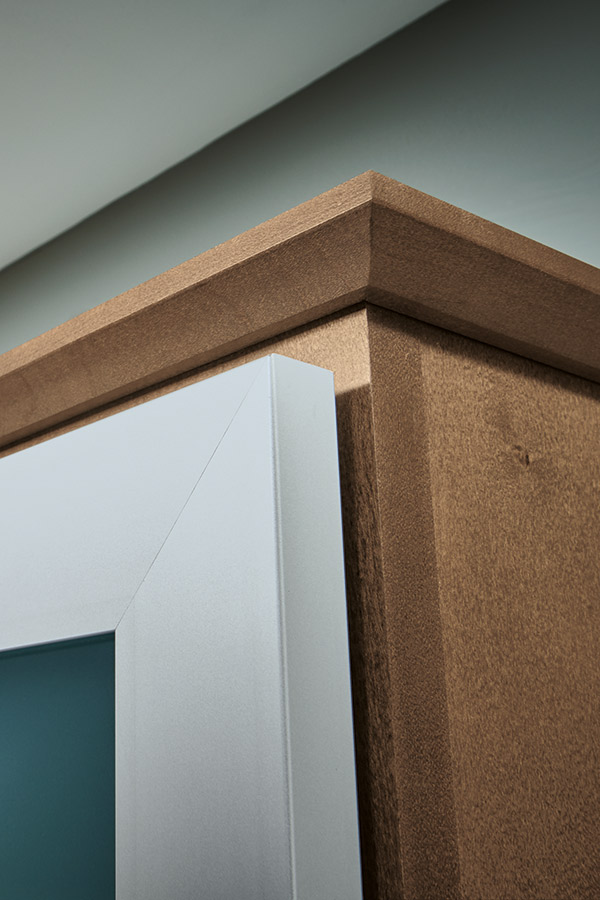 Close-up of cap moulding on Maple kitchen cabinets