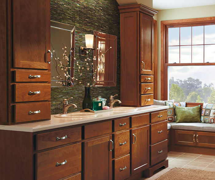 Cherry bathroom cabinets by Homecrest Cabinetry