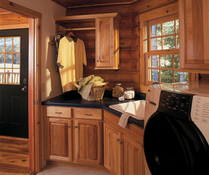 Laundry room cabinets in Natural Hickory by Homecrest Cabinetry