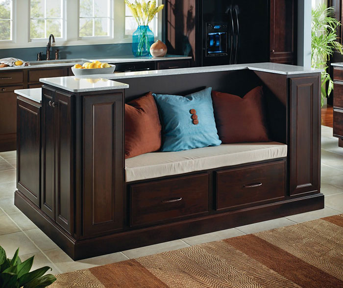 Java cabinets featuring a kitchen island with seating by Homecrest Cabinetry