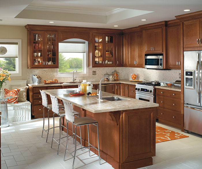 Traditional kitchen with Cherry cabinets by Homecrest Cabinetry