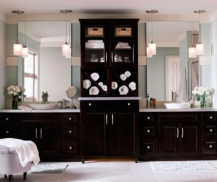 Java Cherry cabinets in a contemporary bathroom by Homecrest Cabinetry
